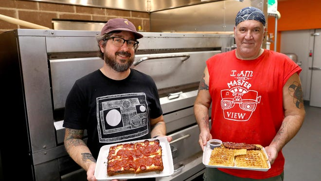 Mark Rodriguez, left, and Satchel Raye pose at the new Satch Squared on June 8 in Gainesville. The new restaurant will specialize in a waffle breakfast and a Detroit-style pizza.