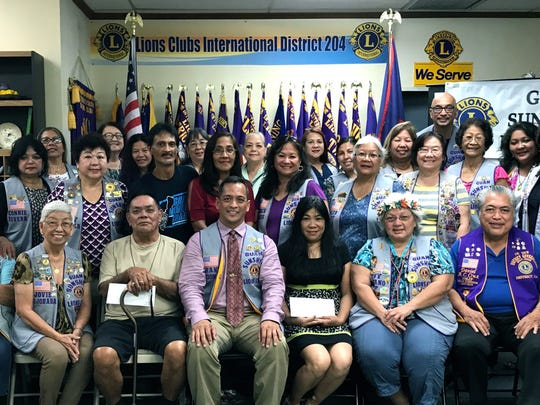 "In its continuing service of ""Caring for the Sick and the Elderly,"" and to help defray medical treatment costs, the Guam Sunshine Lions Club donated $200 each to: Pedro Meno (seated, 4th from left); Don Sarusal (Monica Sarusal seated, 6th from left, received donation on his behalf) and Cecilia Mendiola (Dora Mae Mendiola, standing, 11th from left, received donation on her behalf) during its general membership meeting on Sept. 19.  Photo by: Marietta Camacho"