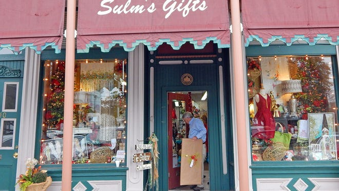 A shopper find the perfect present during the Merchant's Holiday Open House weekend in Canton.