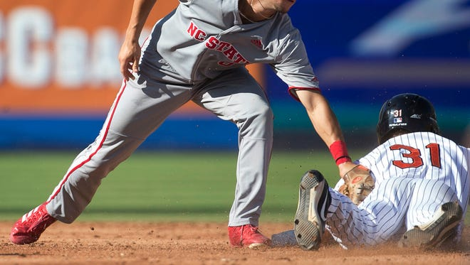 Virginia's Jake McCarthy (31) slides safely into second base beating the tag by North Carolina State shortstop Will Wilson (8) during the third inning in the Atlantic Coast Conference NCAA college baseball tournament, Thursday, May 24, 2018, at Durham Bulls Athletic Park in Durham, N.C.