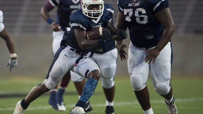 Park Crossing's Uziah McDaniels (6) runs downfield during the game Friday, Aug. 25, 2017, in Montgomery, Ala.