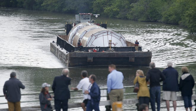 One of the barges carrying beer tanks for Genesee Brewing Co. makes its way along the Erie Canal, approaching Lock 32 in Pittsford..