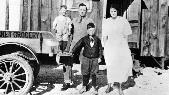 ilt Hicks (standing on truck) Alvah Hicks, Harold Hicks and Theresa Hicks at the Hicks' homestead.