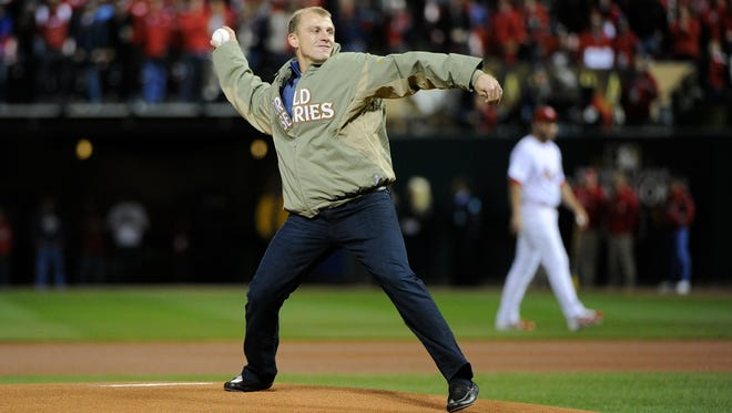 David Eckstein, throwing out the first pitch at a 2011 World Series game, wants to get back in the game.
