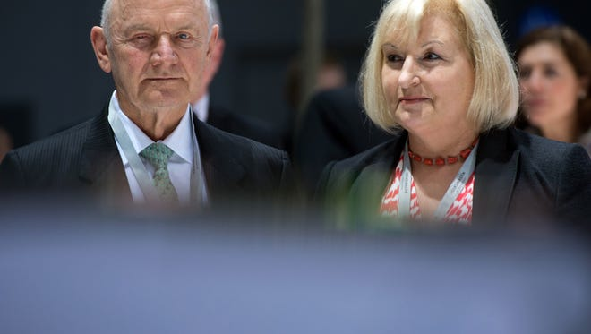 In this April 25, 2013 file photo Chairman of the board of Volkswagen AG Ferdinand Piech and his wife Ursula Piech, member of the board, arrive for a meeting of Volkswagen AG in Hannover, northern Germany. Piech and his wife will step back from their posts as Volkswagen announced on Saturday, April 25, 2015.