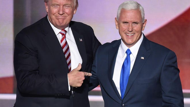 Republican Presidential Candidate Donald Trump points at vice presidential candidate Mike Pence at the end of the third day of the Republican National Convention.