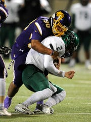 Wylie linebacker Anthony Guerrero (30) tackles Kennedale quarterback Evan Jowers (2) for a loss during the third quarter of the Bulldogs' 21-13 win in the Class 4A Div. I state semifinal playoff on Friday, Dec. 9, 2016, at Birdville Fine Arts/Athletics Complex.