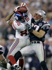 In this Feb. 3, 2008, file photo, the New York Giants receiver David Tyree (85) catches a 32-yard pass in the clutches of New England Patriots safety Rodney Harrison (37) during the fourth quarter of the Super Bowl XLII football game at the University of Phoenix Stadium on Sunday, Feb. 3, 2008 in Glendale, Ariz. The New England Patriots are back in the Super Bowl against the New York Giants, the team that ruined their perfect season in that game four years ago. They advanced with one of Tom Brady's worst games of the season and unheralded Sterling Moore's best. (AP Photo/Gene Puskar)