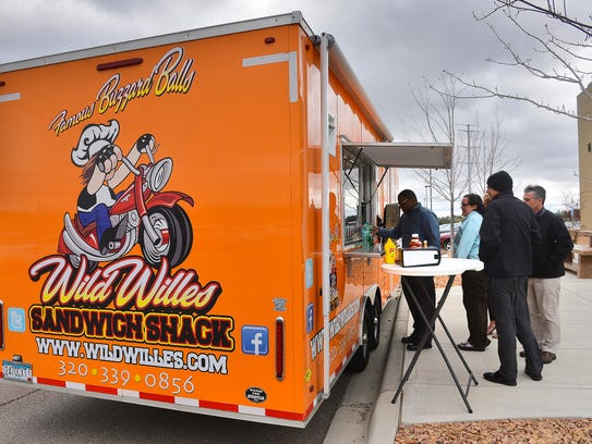 The Wild Wille's Sandwich Shack truck is easily spotted in a crowd thanks to its bright color.