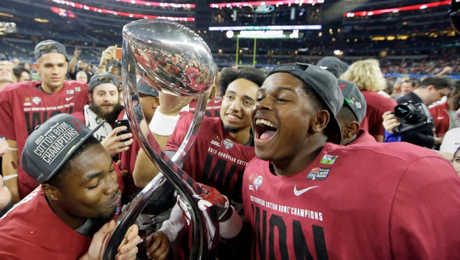 Alabama players celebrate after the Cotton Bowl NCAA college football semifinal playoff game against Michigan State, Thursday, Dec. 31, 2015, in Arlington, Texas. Alabama won 38-0 to advance to the championship game. (AP Photo/LM Otero)