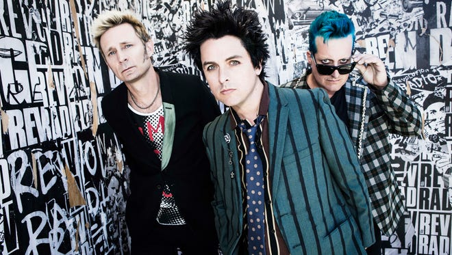 Mike Dirnt, left, Billie Joe Armstrong and Tre Cool of Green Day.