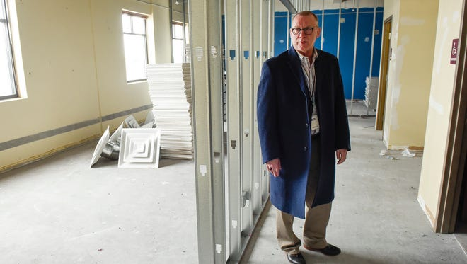 Gary Ganje, executive director of operations for the St. Cloud Area School District, tours the renovations to the new district office building Tuesday, Feb. 27, in Waite Park.