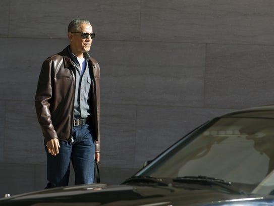 Former president Barack Obama leaves the National Gallery
