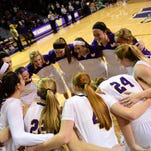 Waukee players huddle before the game on Tuesday, November 24, 2015, during a basketball game at Waukee High School.