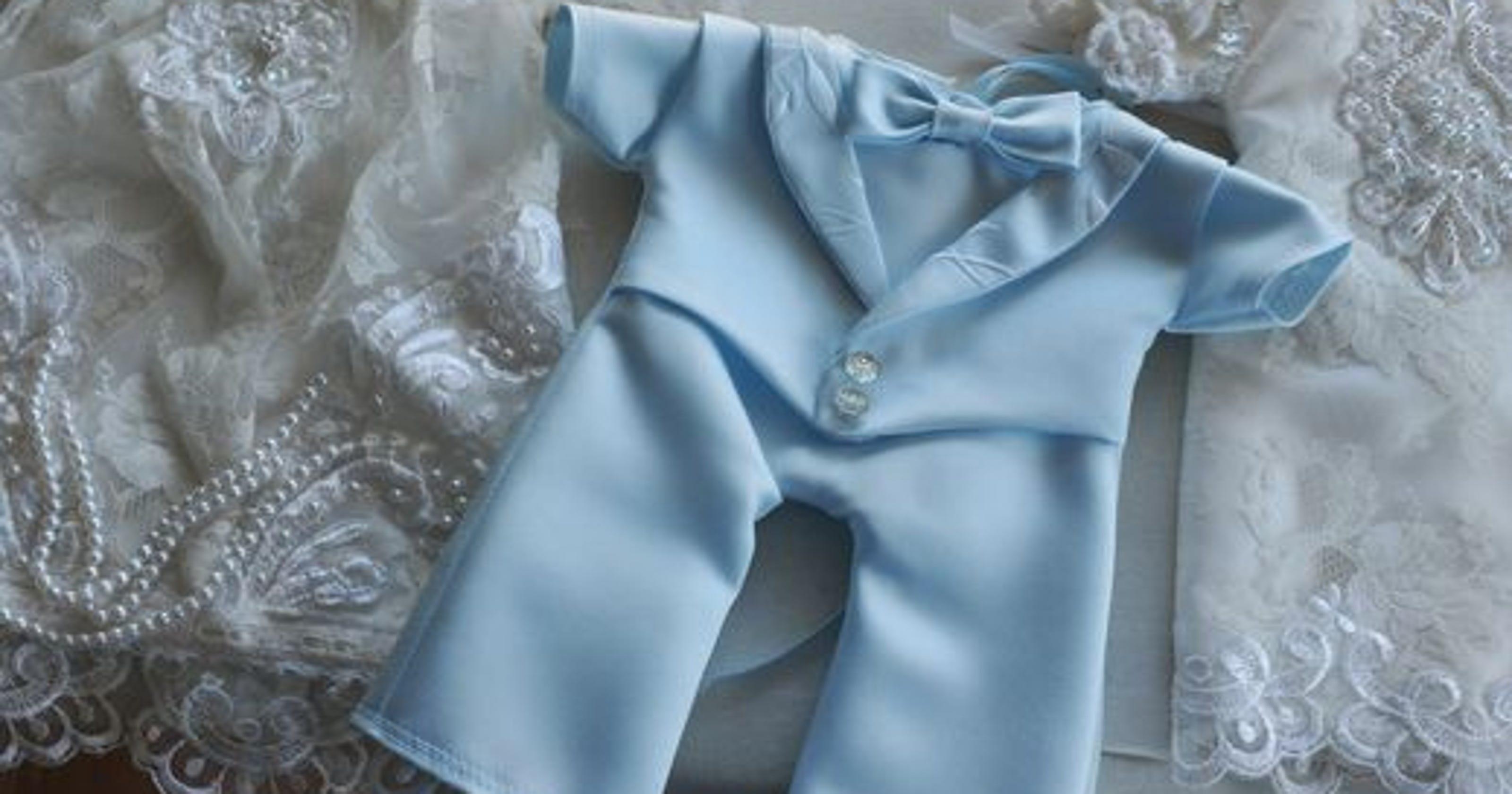 Volunteers dedicate themselves to sewing \'angel gowns\'