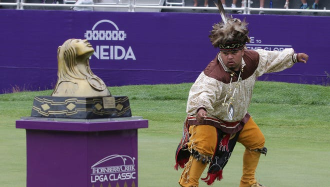 An Oneida Nation member performs a ceremonial dance near the trophy at Thornberry Creek following the LPGA Classic Sunday July 9, 2017 in Hobart, Wis.