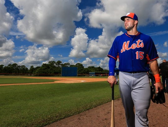 Tim Tebow works out at an instructional league day