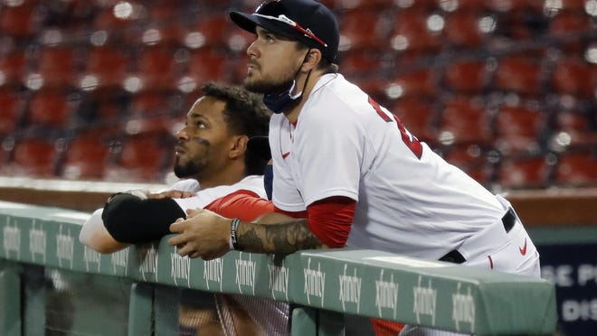 Michael Chavis, right, and Xander Bogaerts watch the final fly out by Jackie Bradley Jr. on Saturday.