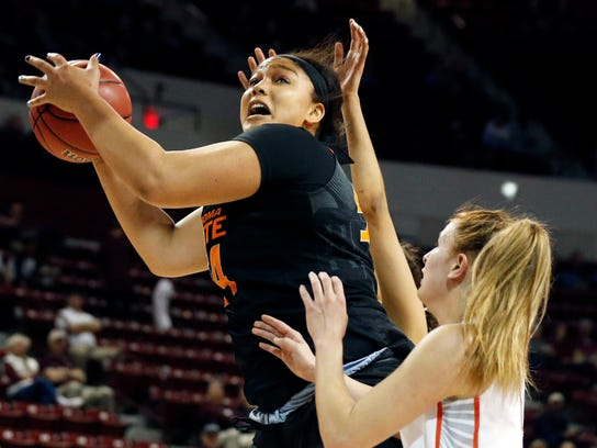 Oklahoma State center Kaylee Jensen (54) pulls down an offensive rebound past a Syracuse defender during a first-round game in the NCAA women's college basketball tournament in Starkville, Miss., Saturday, March 17, 2018. (AP Photo/Rogelio V. Solis)