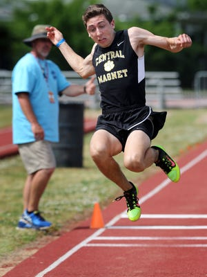 Central Magnet's Ben Waldecker competes in the triple jump during the decathlon at TSSAA Spring Fling in Murfreesboro.