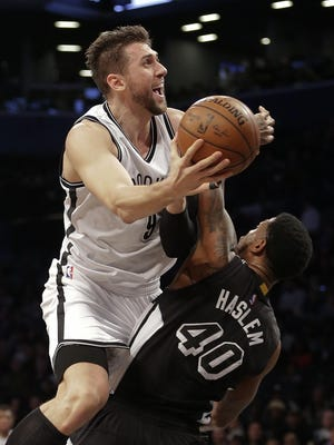 Brooklyn's Andrea Bargnani, shooting over Miami's Udonis Haslem, is not a good defender.
