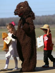 Tina Gage, dressed as a bear, marches with her granddaughter Anna Gage, a kindergartner dressed as Goldilocks, during the character parade at South Elementary School in Jackson on Friday, March 3, 2017.