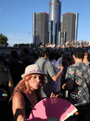 """Teresa Bradley from Nashville dances to John """"Jammin"""" Collins during the Movement Electronic Music Festival at Hart Plaza in Detroit, Sunday, May 27, 2018."""