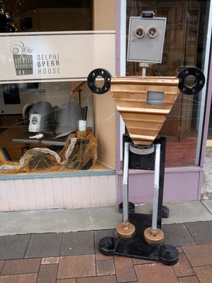 """A Robot stands outside the Delphi Opera House to highlight the upcoming performances of """"Robots"""" Tuesday, June 19, 2018, in Delphi. """"Robots"""" will be performed June 22, and 23 at 7:30 p.m. and Sunday, June 24 at 3 p.m. at the Delphi Opera House."""