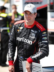Will Power puts a sticker on his car after winning the pole position for the IndyCar Series auto race Saturday, July 7, 2018, at Iowa Speedway in Newton, Iowa. (AP Photo/Charlie Neibergall)