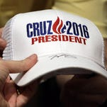 Ted Cruz hands an autographed hat to a supporter at Woodrow Wilson Middle School, Sunday, April 24, 2016, in Terre Haute, Ind.