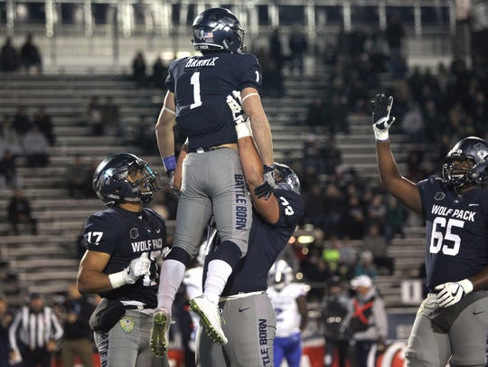 Austin Corbett lifts up wide receiver McLane Mannix in celebration after Mannix scored in a game last season.