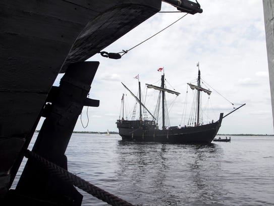 A replica of the Pinta approaches the dock at the Marina at Edison Ford in Fort Myers behind the Nina.