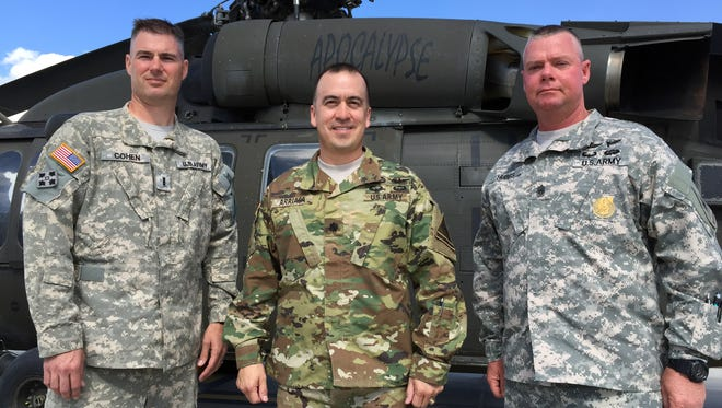 From left, Chief Warrant Officer 3 (promotable) Justin Cohen, battalion command chief warrant officer; battalion commander Lt. Col. Jason Arriaga; and battalion Command Sgt. Maj. Troy S. Hubbs, the battalion's senior enlisted leader, lead the 3rd Battalion, 501st Aviation Regiment.