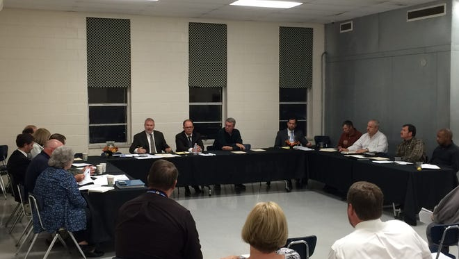 Dickson County School Board members and members of the county commission meet Thursday night at Charlotte Middle School to discuss the new proposed new middle school