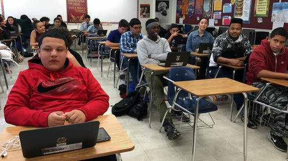"Andress High School sophomores use their laptops to answer questions about the book ""Lord of the Flies"" in an English II class."