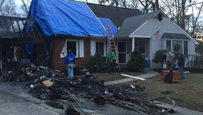 Two women are accused of trying to kidnap a child from a Lafayette Court home they had allegedly set afire in Washington Township.