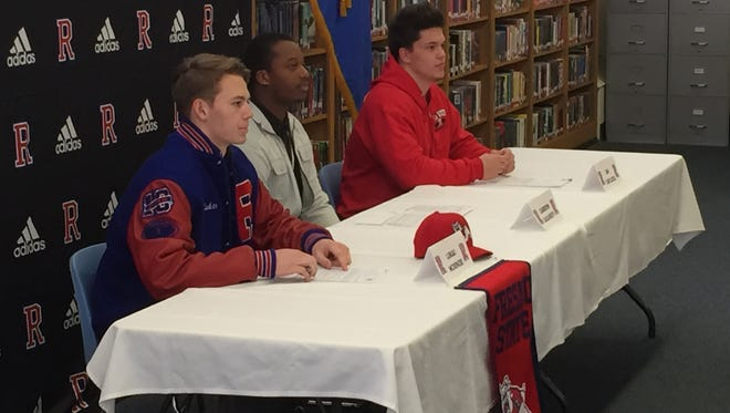Reno High had three football players sign on Wednesday. From left to right, Lukas McKenzie signed with Fresno State; Cameron Daugherty signed with Southern Oregon and Ian Cartlidge signed with Dixie State.