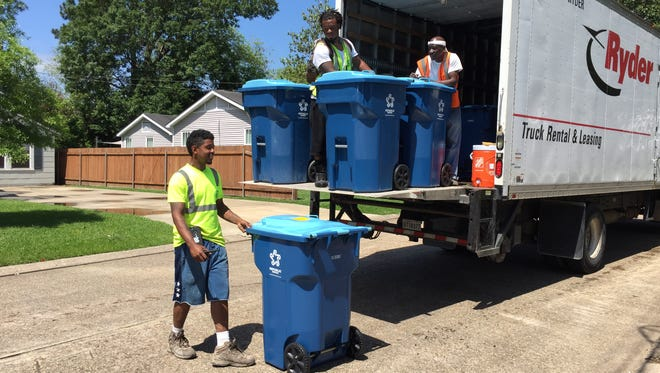 Workers began delivering new Republic Services recycling bins in Lafayette, LA, April 20, 2016.