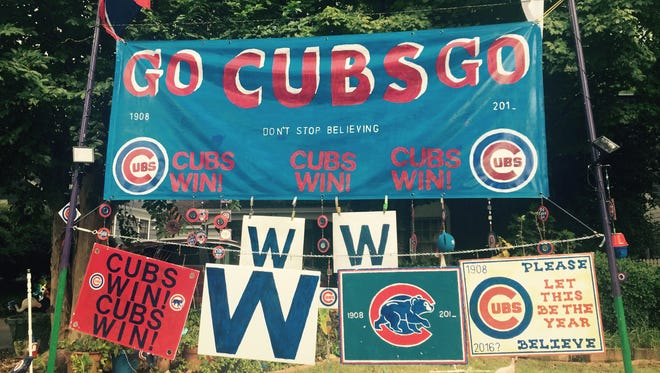 Bob Miller has turned the front yard of his house on Greer Avenue into a shrine for the Cubs.