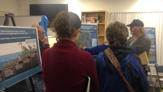 Dozens of Eastern Shore of Virginia residents attended an open house in Wachapreague, Virginia on Tuesday, Dec. 6, 2016 to ask questions and submit comments about a proposal to use dredging spoils off Wachapreague to build up wetlands and protect the shoreline.