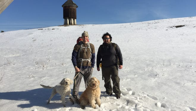 Jeremy Smith and Santino Romero with Smith's dogs, Daisy Buchanan and Gatsby, as they hike north from the Appalachian Trail rail stop in Pawling.