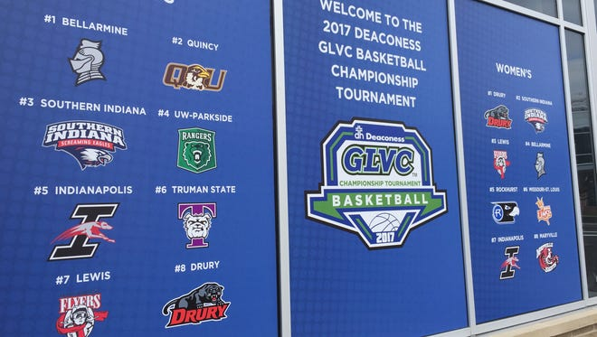 A ground-level window at the Hilton DoubleTree in Downtown Evansville is adorned with GLVC logos. The conference basketball tournament begins Thursday.