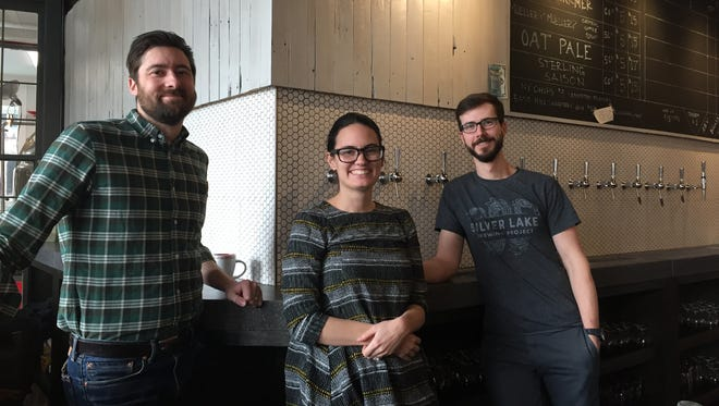 Ryan Fitzsimmons, left, Pilar McKay, center, and Tony Jones, the three managing partners at the Silver Lake Brewing Project.