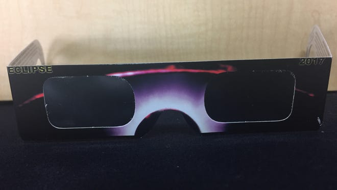 The Great American Solar Eclipse is Aug. 21, 2017. Shown are eclipse glasses approved by the American Astronomical Society.