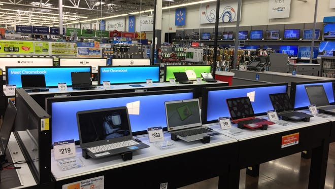 The new electronics department at the Walmart near Elsmere features lower, interactive tables.