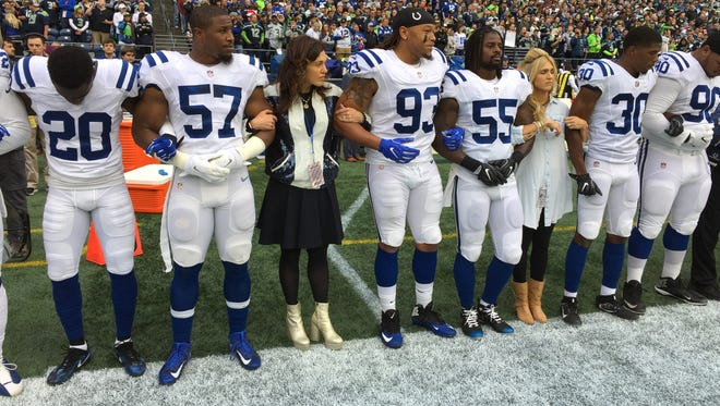 Two of Jim Irsay's daughters  joined Indianapolis Colts players during the national anthem Sunday night.
