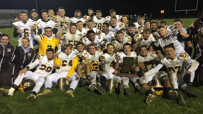 Monroe Central poses with the trophy after winning the first sectional title in program history.