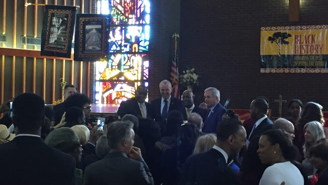 NJ Gov. Phil Murphy poses for photos after speaking during services at St Stephen AME Zion Church in Asbury Park