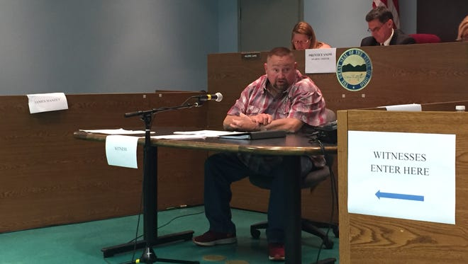 James Hanzey testifies during a hearing Monday night about his conduct as chief of the Buckeye Lake Police Department. Council members voted 5-2 to terminate Chief James Hanzey as the Buckeye Lake Police Chief.