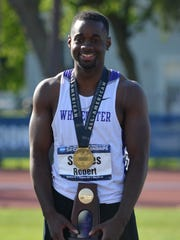 UW-Whitewater freshman and Green Bay Preble alum Robert Starnes receives his medal and championship trophy after winning the NCAA Division III national title in the high jump on May 23 in Canton, N.Y., by clearing 7 feet, 1/4 inch.